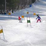 Skiers down course